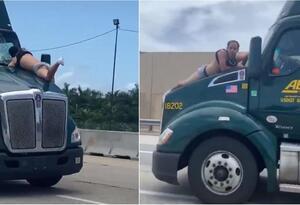 Hombre aferrado a un camión