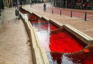 Tiñen de rojo el eje ambiental de Bogotá como protesta a las masacres