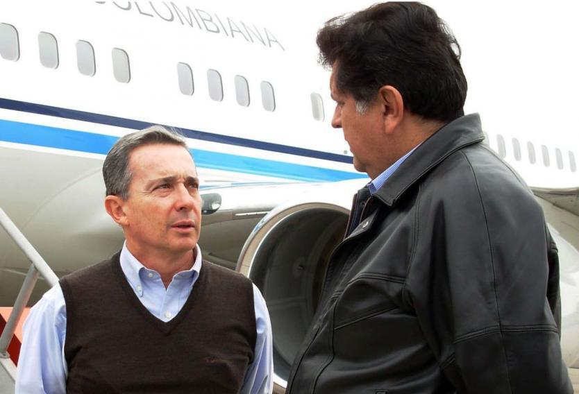 Álvaro Uribe y Alan Garcia.